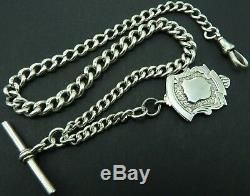 Antique silver albert pocket watch guard chain circa 1900 with silver fob medal