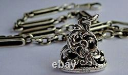 Antique solid silver fancy pocket watch albert chain & silver fob seal. 43.6g